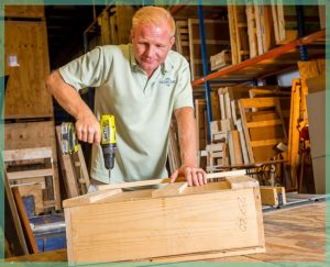 staff member building a crate - packing and crating moving services in our climate controlled storage facility | William C. Huff Companies - Moving & Storage