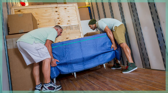 William C. Huff movers loading a moving van for a Naples, FlL residential move. | William C. Huff Companies Moving & Storage