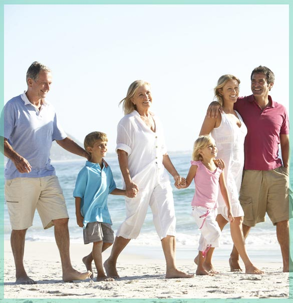 Multi-generational family walking on the beach - we provide moving and storage services for homeowners | William C. Huff Companies - Moving & Storage